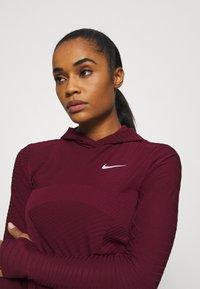 Nike Performance - HOODIE RUNWAY - Sports shirt - dark beetroot - 3
