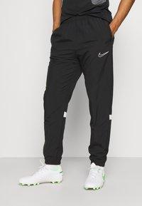 Nike Performance - PANT - Teplákové kalhoty - black/white - 0