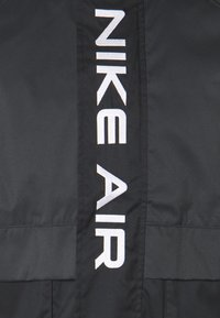 Nike Sportswear - AIR  - Waterproof jacket - black/dark smoke grey/white - 5