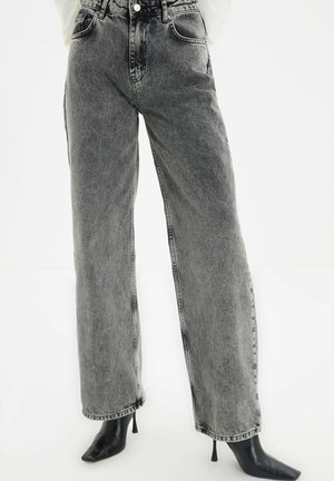 PARENT - Flared Jeans - grey