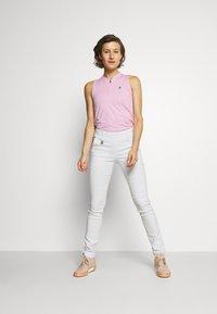 Peak Performance - TURF ZIP  - Polo shirt - statice lilac - 1