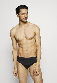 Calvin Klein Swimwear - BRIEF - Costume da bagno - black - 0