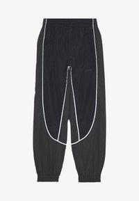 Molo - ARKUU - Tracksuit bottoms - black - 0