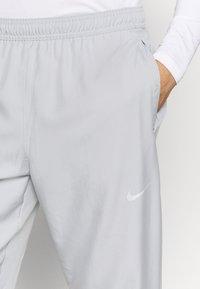 Nike Performance - ESSENTIAL PANT - Tracksuit bottoms - light smoke grey/smoke grey/silver - 3