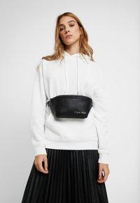 Calvin Klein - DIRECT WAISTBAG - Bum bag - black - 5
