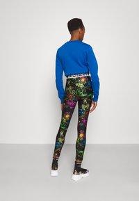 Versace Jeans Couture - Leggings - Trousers - black/multi coloured - 2