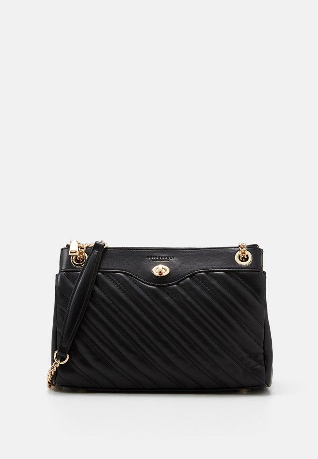 VANTAA - Handtasche - black