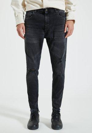 Zúžené džíny - dark grey