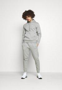 Calvin Klein Golf - PLANET - Tracksuit bottoms - grey - 1