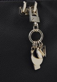 Guess - HANDBAG DESTINY SOCIETY CARRYALL - Handbag - black - 4