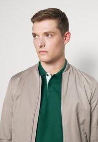Tommy Hilfiger - CONTRAST PLACKET SLIM  - Polo shirt - rural green - 3