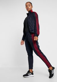 adidas Performance - SNAP - Tracksuit bottoms - dark blue - 1