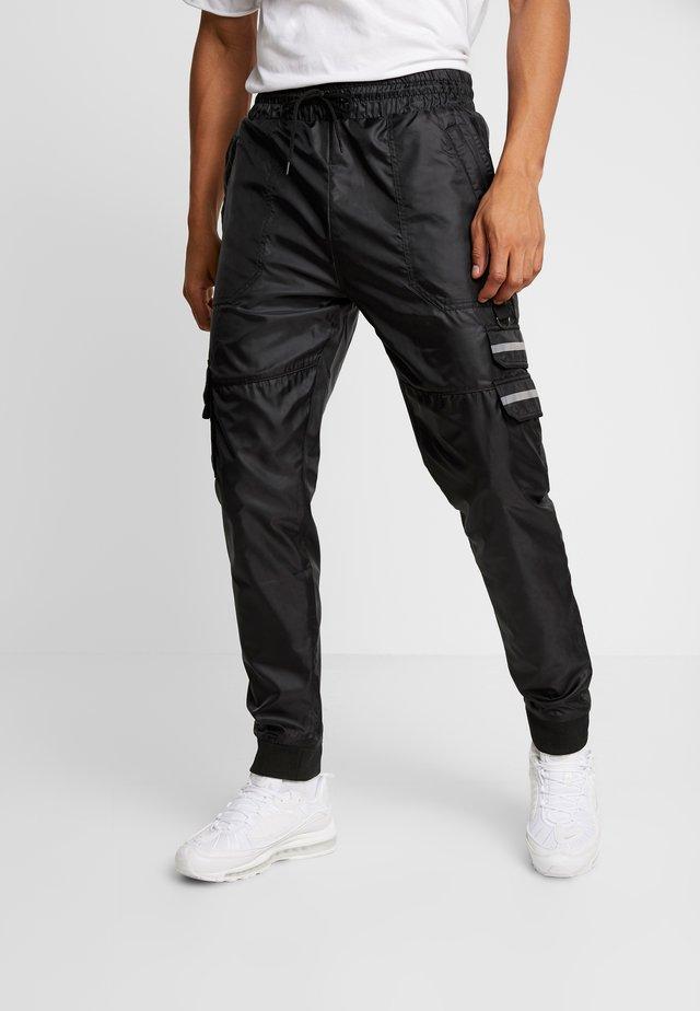 RIGA  - Cargo trousers - black