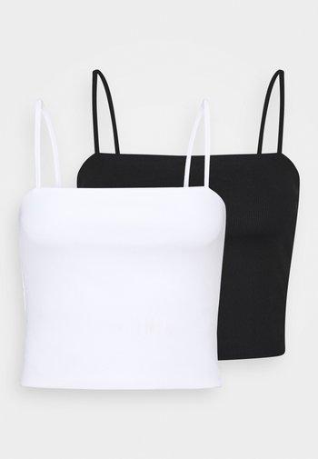 Top - black dark/white light