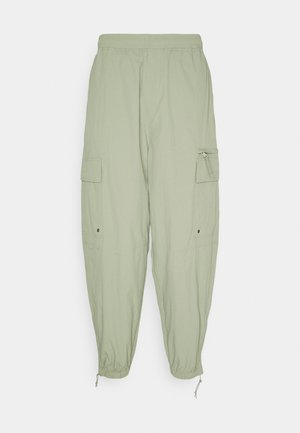SCOTTIE BAGGY JOGGERS UNISEX - Tracksuit bottoms - light khaki green