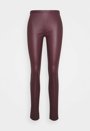 PLAIN WITH ZIP AT TOP - Leather trousers - bordeaux