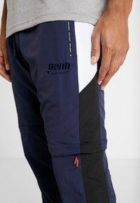Penn - MENS ZIP OFF TRACK PANT - Tracksuit bottoms - navy/black - 5