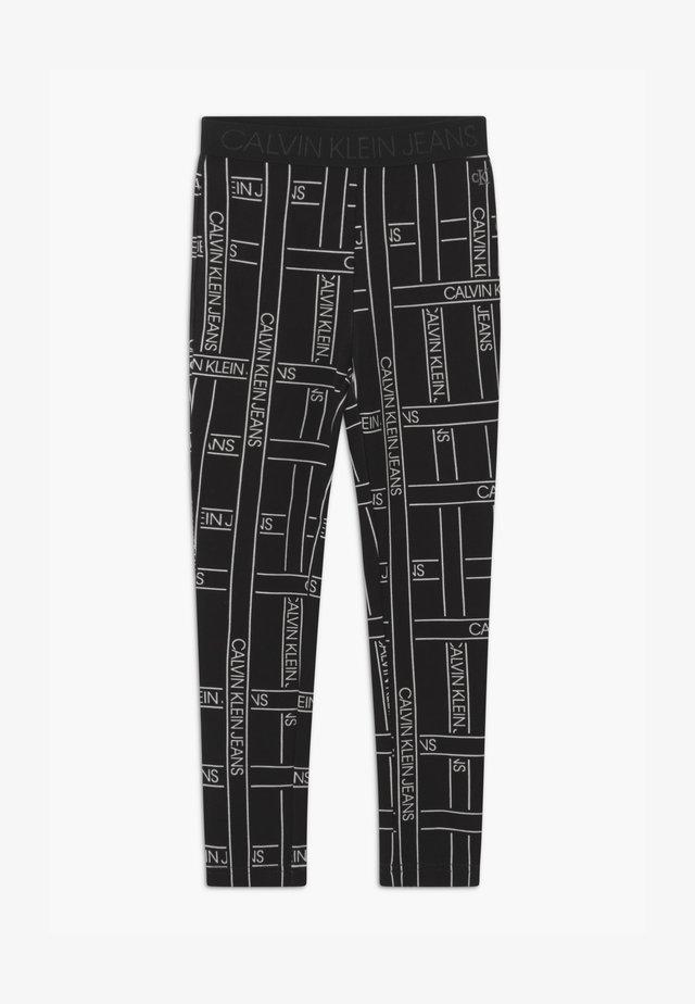 LOGO TAPE - Leggings - Trousers - black