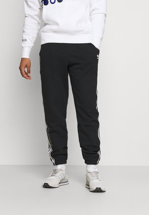 NINJA PANT UNISEX - Trainingsbroek - black