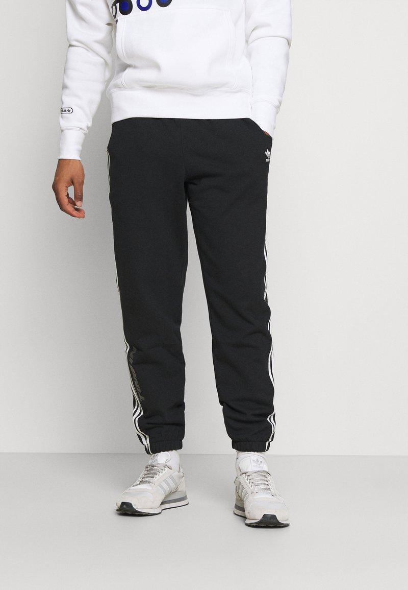 adidas Originals - NINJA PANT UNISEX - Tracksuit bottoms - black