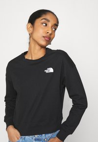 The North Face - ENSEI TEE  - T-shirt à manches longues - black
