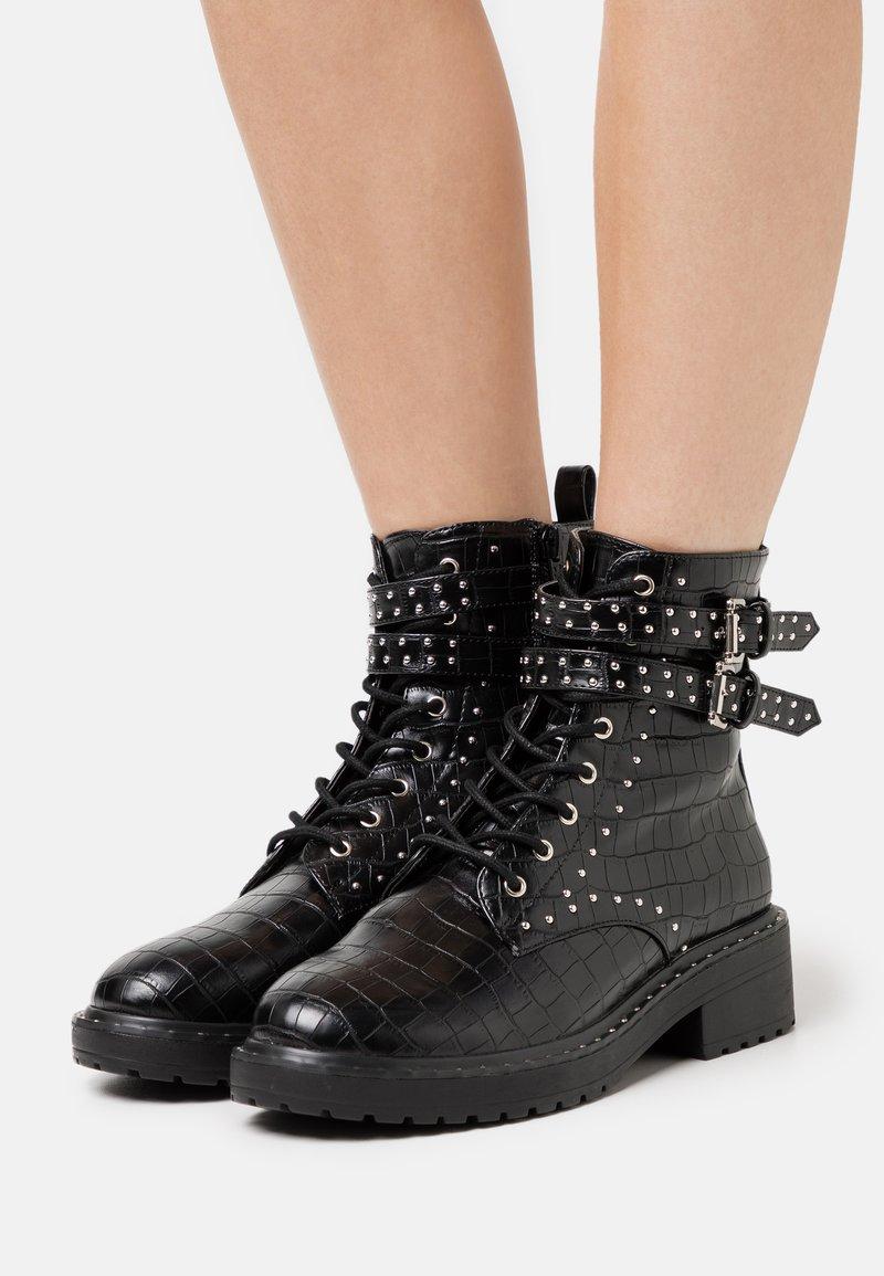Dorothy Perkins - MAJESTIC STUD LACE UP BOOT - Kovbojské/motorkářské boty - black