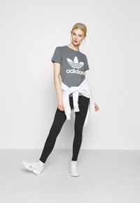 adidas Originals - Leggings - Trousers - black - 1