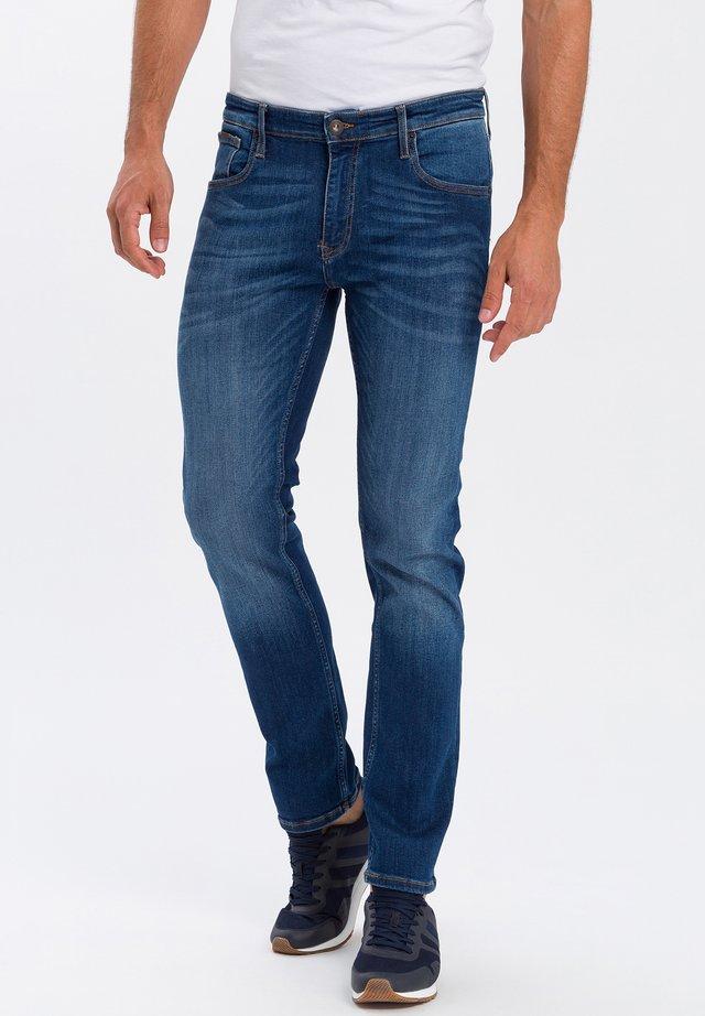 DAMIEN - Slim fit jeans - mid blue