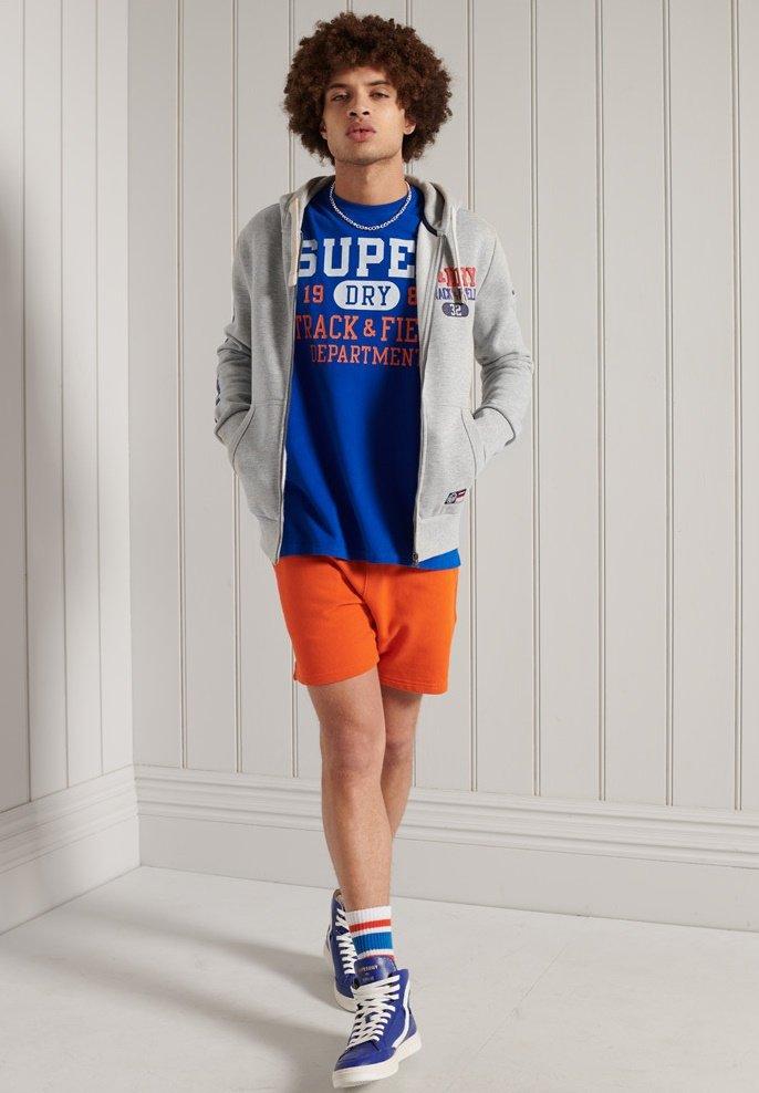 Men SUPERDRY TRACK & FIELD GRAPHIC - Zip-up sweatshirt
