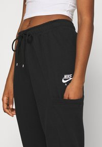 Nike Sportswear - AIR PANT - Pantalon de survêtement - black - 4