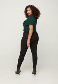 Zizzi - SPARKLY  - Leggings - Trousers - black - 1