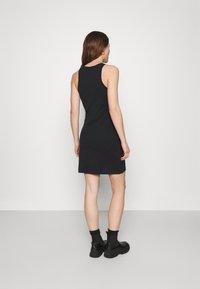 Calvin Klein Jeans - LOGO RACER BACK DRESS - Jersey dress - black - 2