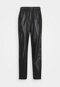 UNISEX - Trousers - shiny black