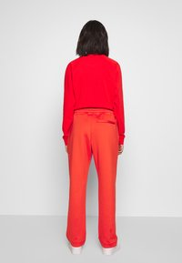 Lacoste - HF5430-00 - Tracksuit bottoms - red - 2