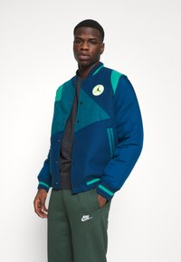 Nike Sportswear - CLUB PANT - Tracksuit bottoms - galactic jade/white - 3