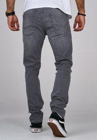 Jack & Jones - CLARK JJARIS  - Straight leg jeans - grey denim - 1