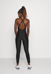 P.E Nation - DRIVE FORCE CAT SUIT - Gym suit - black/orange - 2