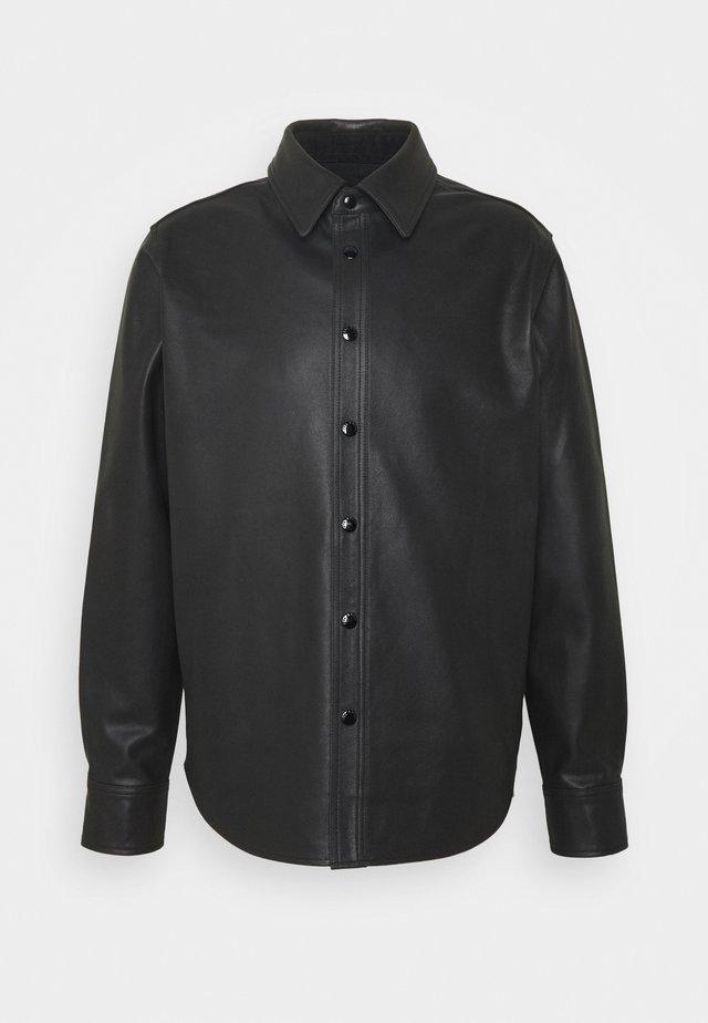 LUCAS - Leather jacket - black