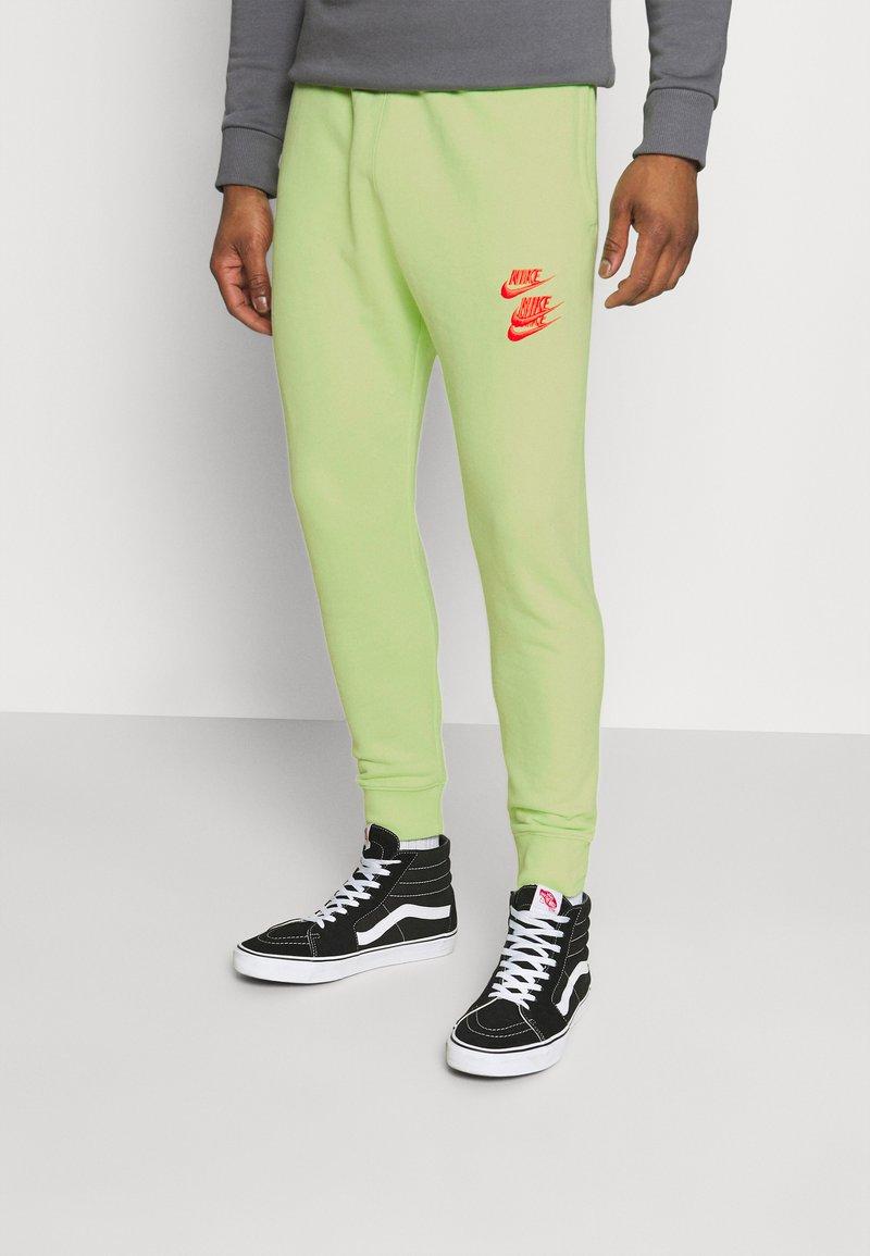 Nike Sportswear - PANT - Tracksuit bottoms - liquid lime