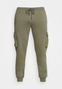 COMBAT - Teplákové kalhoty - khaki