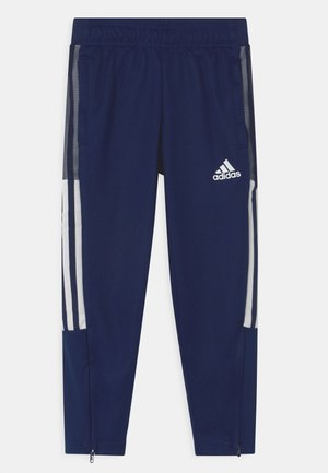 TIRO UNISEX - Tracksuit bottoms - team navy blue