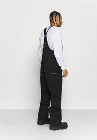 Burton - RESERVE BIB - Snow pants - true black - 2
