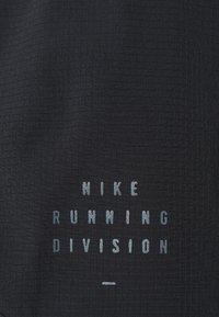 Nike Performance - RUN TEMPO SHORT - Sports shorts - black/bright crimson - 2