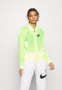 Nike Sportswear - AIR SHEEN - Summer jacket - volt/black - 0