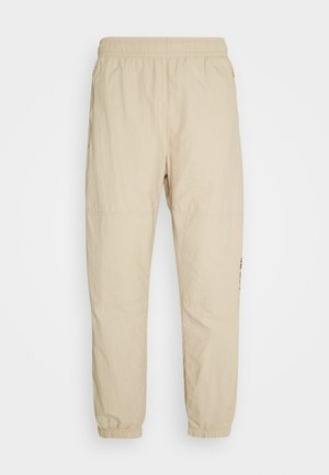 NOVELTY TRACK PANT UNISEX - Teplákové kalhoty - grain/velvet brown