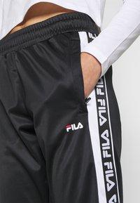Fila - TAO - Teplákové kalhoty - black/bright white - 4