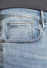 G-Star - 3301 SLIM - Slim fit jeans - elto superstretch - lt indigo aged - 4
