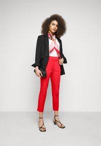WEEKEND MaxMara - FARAONE - Trousers - orange - 1