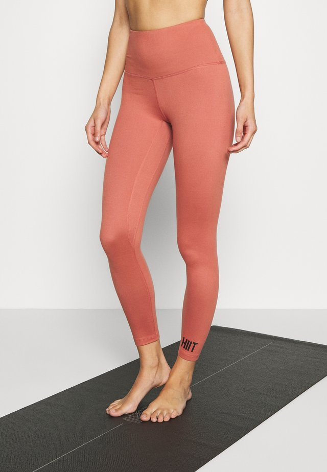 CORE LEG STONE - Leggings - salmon