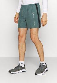 Nike Performance - Sports shorts - hasta/black - 0